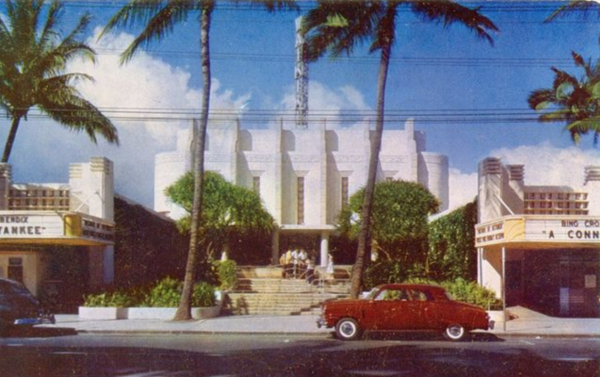 A+photo+of+the+now-demolished+Waikiki+Theater%2C+built+in+1936+in+the+unique+%22Tropical+Moderne%22+style.+Facing+Kalakaua+Avenue%2C+the+1353-seat+theatre+was+designed+by+Hawaii+architect+C.W.+Dickey+and+built+by+the+local+Consolidated+Amusement+Company+as+its+flagship+theatre.+It+also+featured+a+garden+forecourt+with+a+large+fountain%2C+an+ornate+lobby+with+wall+murals+and+ceiling+fresco.+The+auditorium+was+lined+with+artificial+tropical+vegetation%2C+two+full-size+palms%2C+a+rainbow+proscenium%2C+and+a+corps+of+uniformed+usherettes.+Photo+by+Honolulu+Star-Bulletin%2C+June+6%2C+1968.