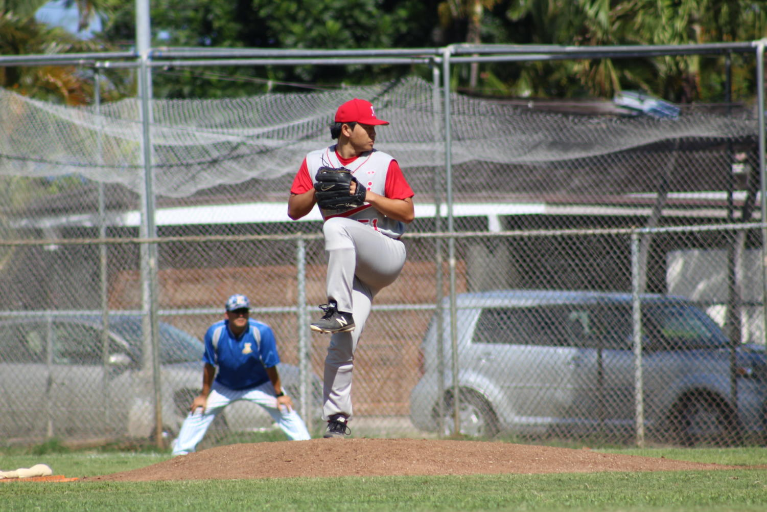 Kalani Senior Edward Lee pitches against Kaiser High School on April 20. Kalani won 4-3 in Game 3 in the OIA Division I playoffs. Photo by Noah Tamura.