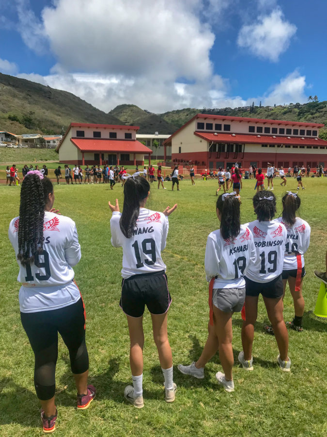 Senior Powder Puff players cheer on their teammates. From left to righ: Kandyce Woods, Ariel Wang, Heidi Kishabi, Jade Robinson, and Daesha Viela. Staff photo 2018.
