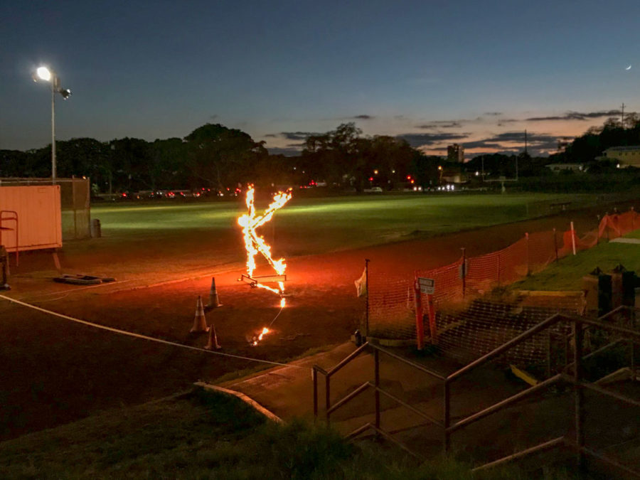"Kalani High School's Night Pep Rally sees the annual burning of the K on the school track. At the rally, held in the Kalani gym, each class performed a Homecoming dance. The dances were choreographed to songs from the musicals that assigned to each class. After the pep rally, students walked to the track to watch ""The Burning of the K"". The students watched the paper K burn from a safe distance as they all sang Kalani's alma mater. Photo by Tiana Chu 2018."