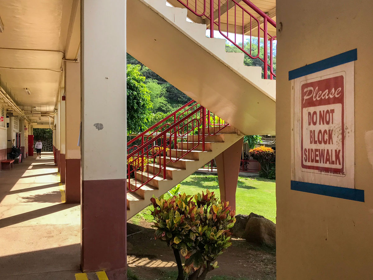 The walkway at A building displays a sign placed by Kalani admin reading