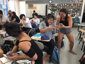 Jazlyn Furuya and Mia Wong play a vocabulary game on Quizlet in Japanese class. School photo 2018.