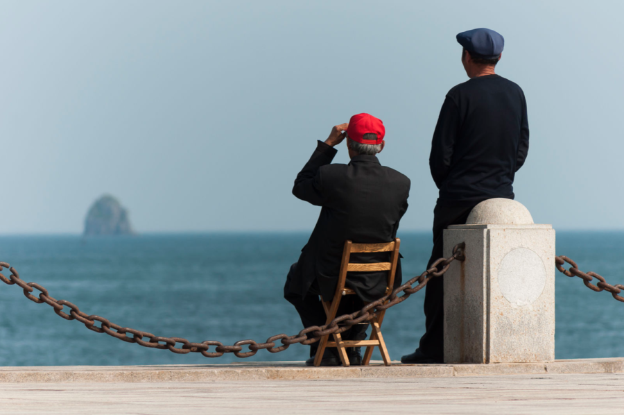 Dalian%2C+Liaoning%2C+China%3A+Two+elderly+Chinese+guys+enjoying+the+sea+at+Xinghai+Bay.+Photo+by+CEphoto%2C+Uwe+Aranas+2018.