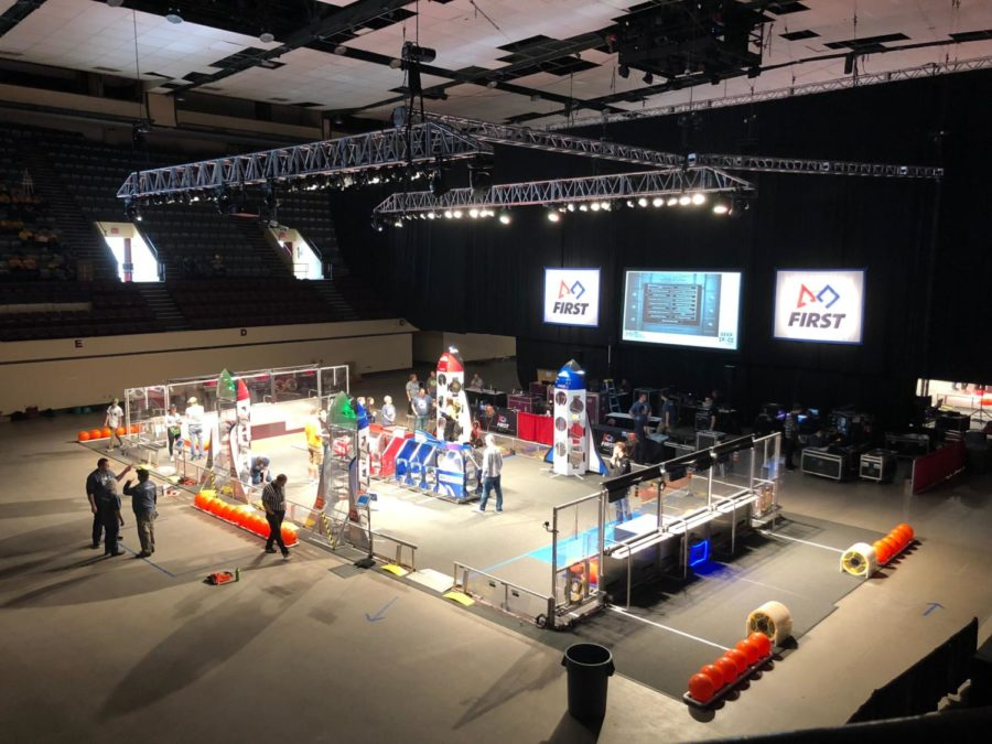 Team Magma watches the field from the stands before practice matches begin at the FIRST Robotics Competition in Duluth, MN. Photo by Sharlene Whang 2019.