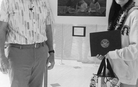 Edward Case, the U.S. Representative for Hawaii's 1st congressional district, stands beside Clara Wu (11) and her artwork entitled