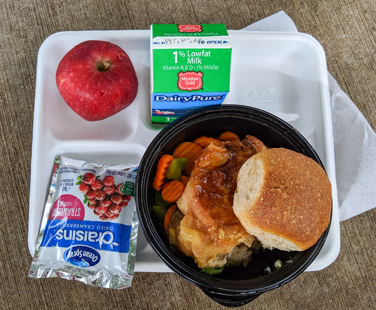 School lunch on Sept. 20 features a breaded chicken sandwich, apple, milk, and juice packet. Nagasawa distributes breakfast and lunch menus every month for Kalani students and faculty. Photo by Lucy Dooley-Carll 2019.