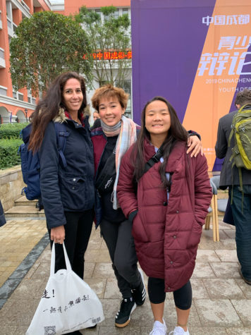 The Kalani Debate team poses in front of a local middle school, the host of the 2019 U.S. Sister Cities Youth Debate Challenge in Chengdu, China on Saturday, Nov. 23 and Sunday, Nov. 24. From the left, Kalani advisor Brooke Nasser, Reina Dreyer (12) and Pearl Lee (12). Photo by Bill Stevens 2019.