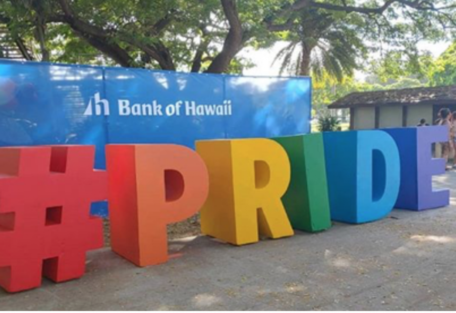 A rainbow PRIDE sign decorates the entrance to the 2019 Honolulu Pride Parade. Photo by Lucy Dooley-Carll 2019.