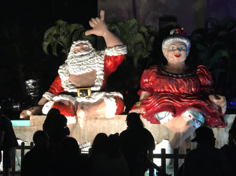 Statues of Santa and Mrs. Claus sit by the Honolulu Town Hall, drawing huge crowds.  The Honolulu City Lights festival takes place in downtown Honolulu by the City Hall, Hawaii State Library and the Frank F. Fasi Civic grounds. Every year, the festival attracts tourists and locals from all across the island from Dec. 7 through Jan. 1. Photo by Zohar McMillan-Zilberman 2019.