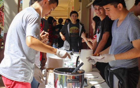 Victor Siu (11), Jose Siliezar (11), Duke Whitney (11) and Athena Huynh (11) sell nachos to raise money for Chess Club. Photo by Annyssa Troy 2020.