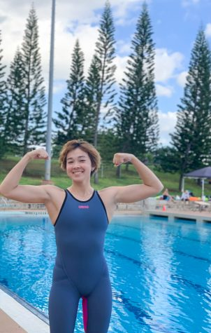 Reina Dreyer (12) flexes as she readies to compete in her final OIA Championship swimming meet. She won three first place medals and one bronze medal, and helped her team win the OIA Championship team title.  Photo by Lin Meyers 2020.