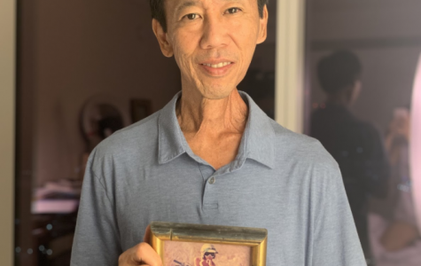 James Kohara posing while holding a picture of his younger self on a motorcycle. Photo by Mina Kohara 2020.