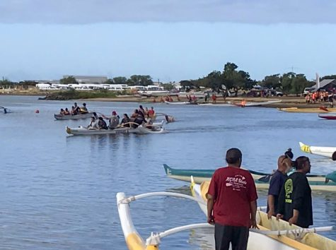 The paddling races come to an end as the Boys Varsity competitors make their way to the starting line for their Na Opio half-mile race, hoping to become this year