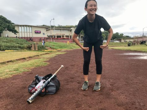 Kady Okamura (11) stretches before a sprint practice in the morning at Kalani High School. As a two-sport athlete, she works out for Track & Field at 6:45 a.m. three days a week, and again after school every day for softball. You can often find her lugging around her bat and gym bag between classes. Photo by Kacie Huang.
