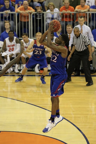 Andrew Wiggins of the Kansas Jayhawks lines up a jump shot in front of the basket on Dec. 10, 2013. Photo by	Dennis Adair.