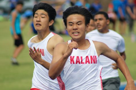 Jay Suh (10) and Aiden Cheung (10) battle down the straight in the 100m dash at the first OIA Track & Field meet of the season at Moanalua High School on March 7. Photo by Monica Mau.