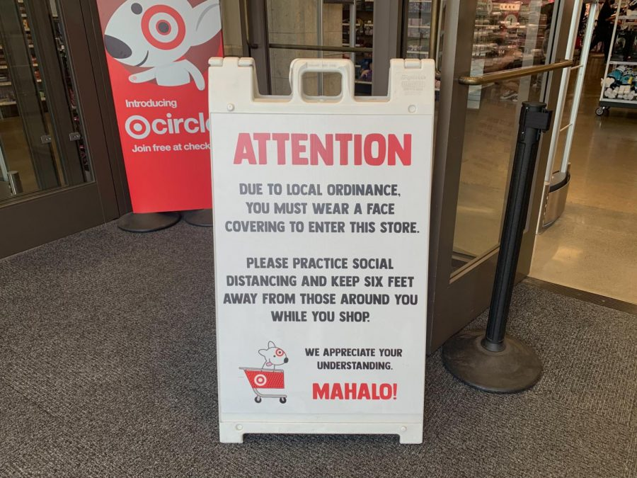 The Target sign at the entrance lets customers know the store's guidelines during the pandemic. The Ala Moana Target hours are from 7 a.m to 11 p.m. It also has Senior hours on Tuesday from 7 a.m. to 8 a.m. Photo and caption by Mina Kohara.