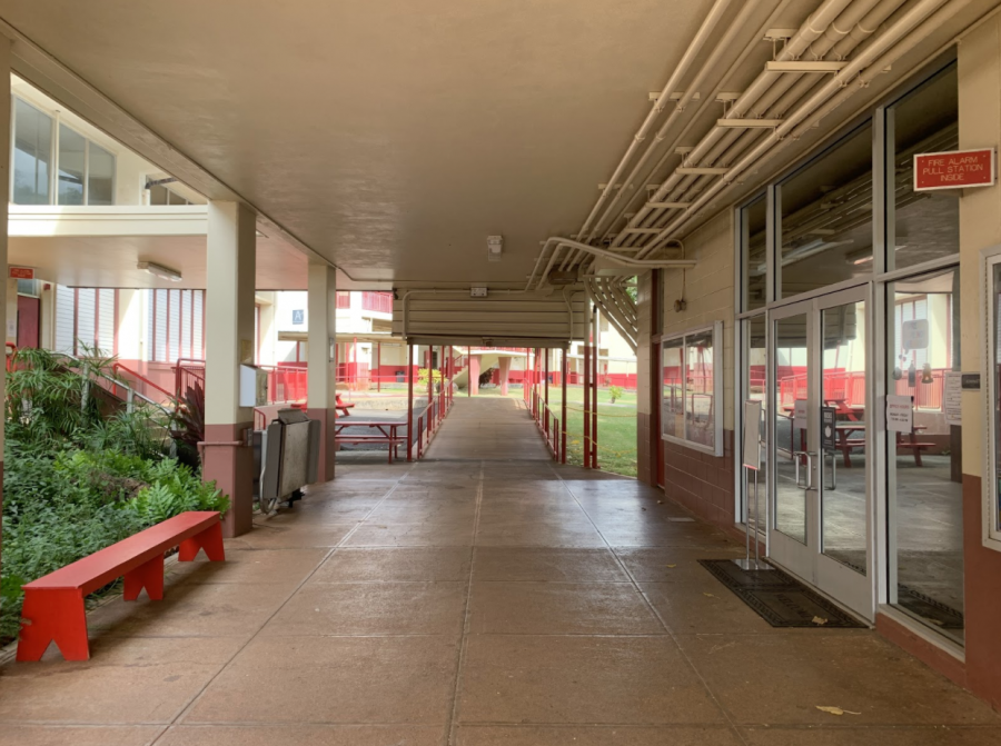 "School halls remain largely empty, even as Kalani High School allows seniors to return to class on Monday, Nov. 23. The majority of students - freshmen, sophomores, and juniors - now receive schooling online, a months-long development that Kalani student Joseph Kim (10) describes as ""kinda scuffed."""