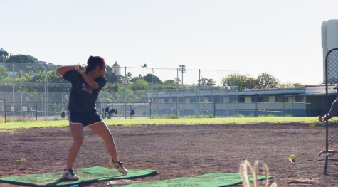 Daynna Mekaru is swinging for the fences as she practices on Dec. 6, at Roosevelt High School softball field so she can be ready for her upcoming season as a sophomore at Mid-Pacific Institute. All public parks are currently open for anyone who wants to exercise, practice, or have a picnic with family or friends. The guidelines for parks in Tier Two are five people maximum and no masks when exercising; however, masks are highly recommended if you're not 6 feet away from a person inside the park. Students should be going to their local parks and staying in shape, especially if they're planning on playing for a Kalani sports team which is tentatively set to resume in 3rd Quarter. Photo and caption by Kylie Tanimura.