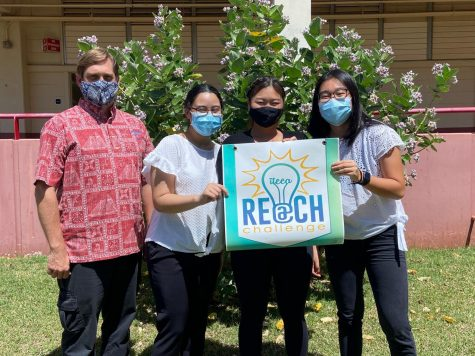 Kalani students Taylor Pimenta, Keili Takamiya, and Esther Wong stand next to their teacher, Mr. Silver, with a poster for the REACH Challenge. Photo courtesy of Taylor Pimenta.