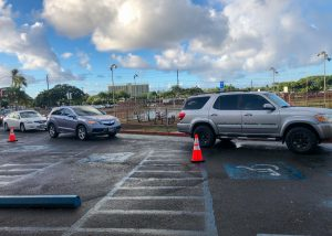 A long line of cars circle the track on Sept. 13 as parents wait to drop off their students at Kalani. Photo by Leilani Phan.