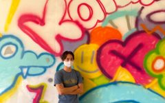 Nick Au (11) stands in front of the mural he designed and created on the hallway wall between B and C Buildings. Photo by Riko Yamaki.