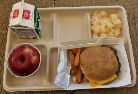 One of the more popular school lunches is the burger and fries. This meal comes with an apple, pineapple, and milk as well. Photo by Eleni Cheng.