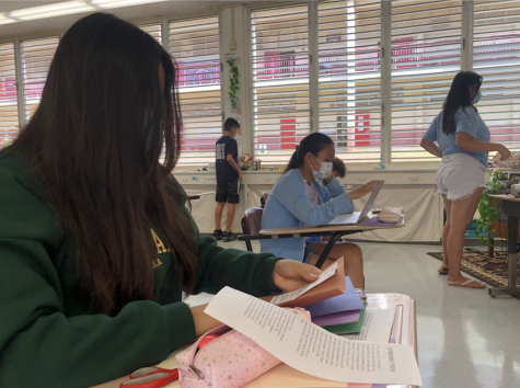 """As we reach the end of the first quarter, freshmen are assembling their chapbooks at Kalani High School! A """"chapbook"""" is a project during the first quarter of every school year for freshmen here at Kalani where new students write a series of poetry and passages about themselves and gather them together into one small book. Photo and caption by Leilani Phan."""